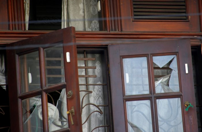 Broken windows are seen at the family home of a bomber suspect where an explosion occurred during a Special Task Force raid, following a string of suicide attacks on churches and luxury hotels, in Colombo, Sri Lanka April 25, 2019. REUTERS