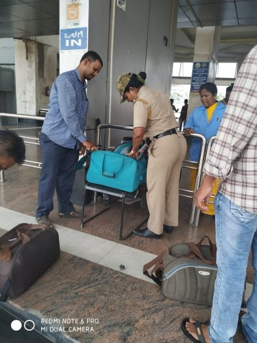 Police manually checking the baggage in KSRTC bus stand.