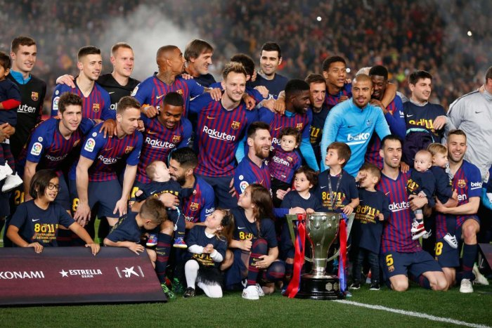 DOMINANT: Barcelona players celebrate becoming La Liga champions on Saturday. AFP