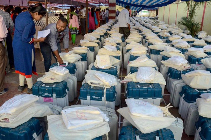 Poll officials collect Electronic voting machines (EVM) and other material from an EVM distribution centre on the eve of the 4th phase of Lok Sabha elections, in Jabalpur. (PTI Photo)