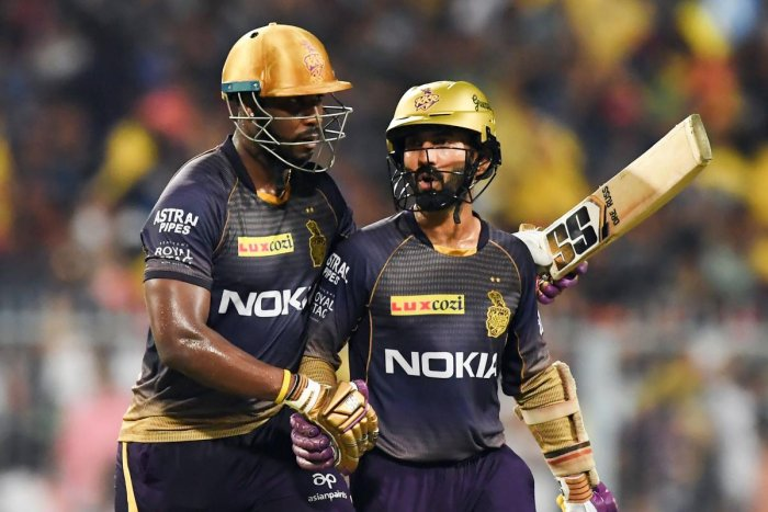Andre Russell (left) with Dinesh Karthik.