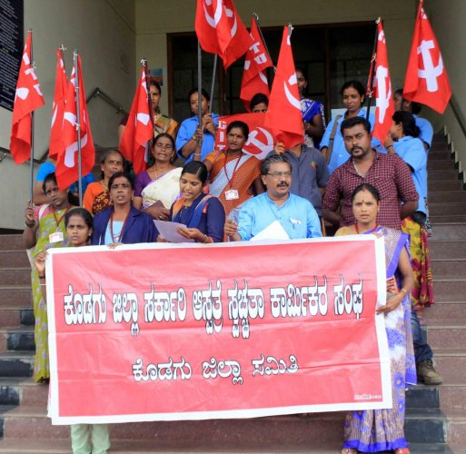 Sanitation workers of the district government hospital staged a protest under the aegis of CITU, in front of the Deputy Commissioner's Office in Madikeri, on Monday.