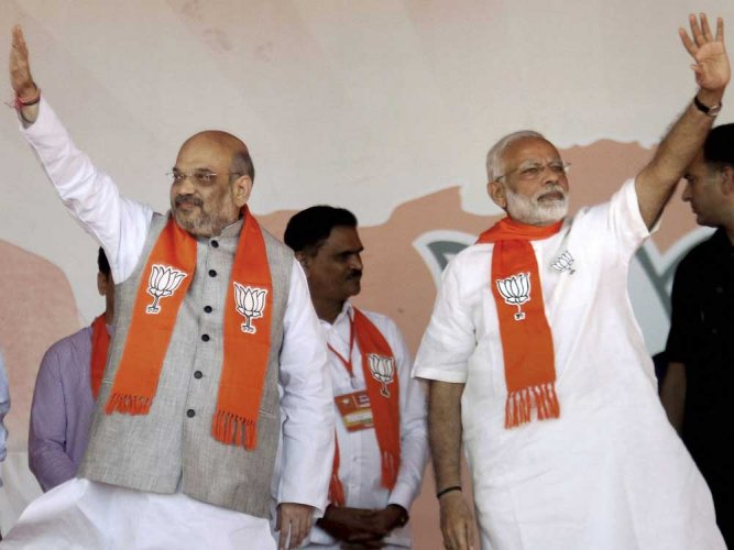 The Congress on Monday piled up pressure on the Election Commission seeking action against Prime Minister Narendra Modi and BJP President Amit Shah over alleged violation of the Model Code of Conduct. (PTI File Photo)