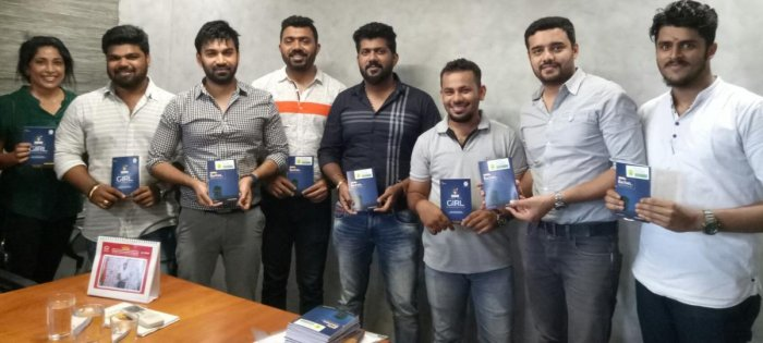 Young entrepreneur Darshan Jain (fourth from left) with like-minded friends during the release of 'Cyber Safe Girl-Beti Ko Bachao, Cyber Crime Se' at ACE office in Empire Mall in Mangaluru on Monday.