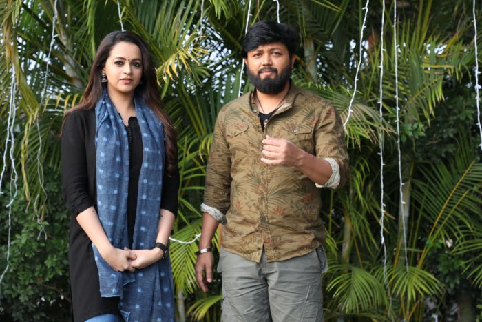 Bhavana and Ganesh in '99', the romantic drama that hit the screens today.