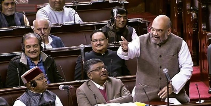 Bharatiya Janata Party (BJP) President Amit Shah speaks in the Rajya Sabha during Winter Session of Parliament in New Delhi on Wednesday. (RSTV grab via PTI)