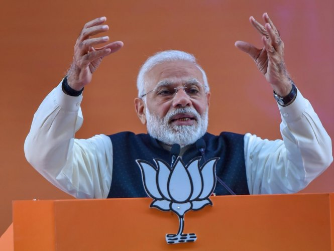 Prime Minister Narendra Modi addresses on the second day of the two-day BJP National Convention, at Ramlila Ground in New Delhi on Saturday. PTI photo