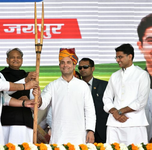 Congress President Rahul Gandhi is being presented a memento during Kisan rally in Jaipur ib Wednesday. Rajasthan Chief Minister Ashok Gehlot and Congress Unit President Sachin Pilot are also seen. (Photo by Suman Sarkar)