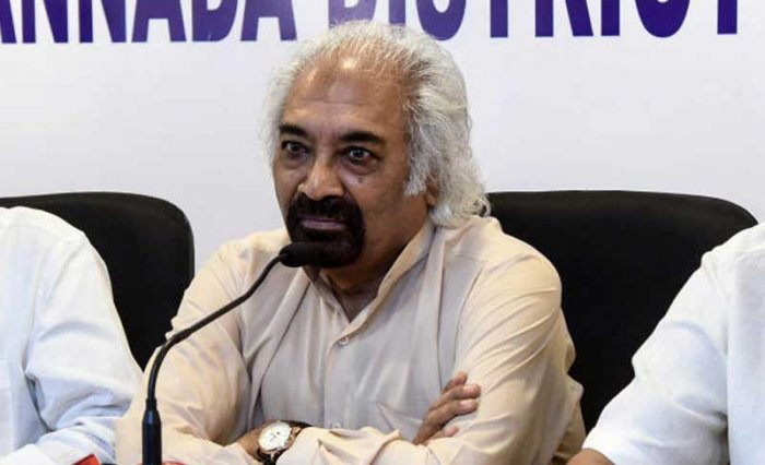Sam Pitroda, Chairman of the Indian Overseas Congress (IOC), flagged off the NRI Campaign Bus from the AICC Headquarters. (DH File Photo)