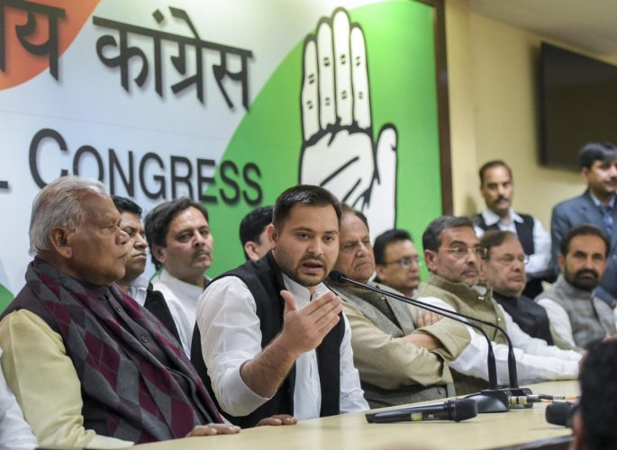 RJD's Tejashwi Yadav, along with other Mahagathbandhan leaders, speak during a press conference at which RLSP leader Upendra Kushwaha joined the grand alliance, at AICC in New Delhi on Thursday. PTI