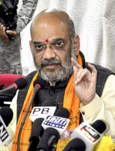 Agartala: Bharatiya Janata Party President Amit Shah addresses a press conference, in Agartala, Saturday, Jan. 05, 2019. (PTI Photo)(PTI1_5_2019_000144B)