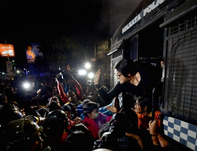 Police detain BJP Mohila Morcha President Locket Chatterjee as she react to a lady POlice constable from the prison van at Hazra crossing near West Bengal Chief Minister Mamata Banerjee's Kalighat residence during a rally to protest against the alleged br