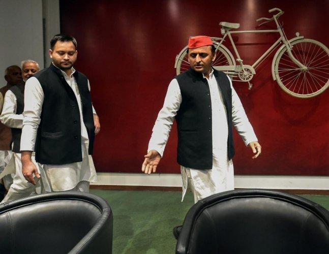 Samajwadi Party chief Akhilesh Yadav and Rashtriya Janata Dal leader Tejashwi Yadav arrive to address a joint press conference at SP office, in Lucknow, on Monday. PTI
