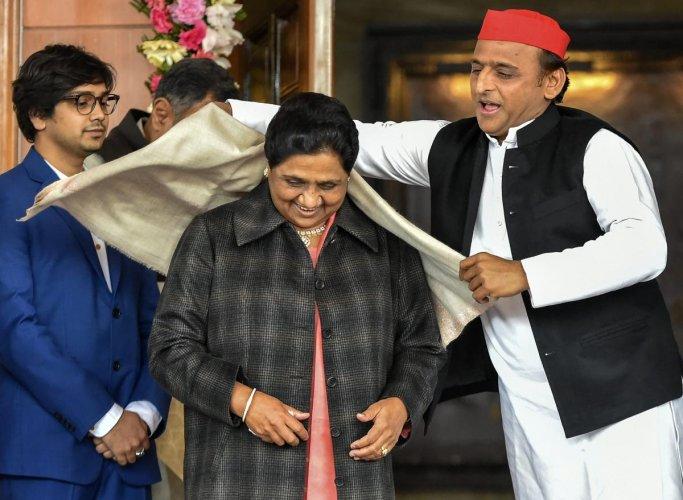Samajwadi Party president Akhilesh Yadav greets Bahujan Samaj Party supremo Mayawati. PTI file photo