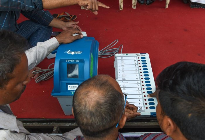 """The CEC also met representatives of the various political parties wherein the JD (U) and Congress appealed to him to hold polls with VVPAT-laced EVMs """"so that a free and fair election is conducted. AFP Photo"""