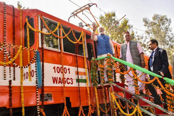 Prime Minister Narendra Modi flags off an electric locomotive converted from a diesel engine at Diesel Locomotive Works (DLW), in Varanasi. PTI photo