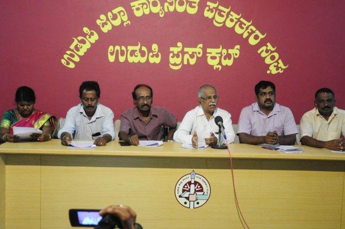 Mass India Mahithi Seva Samithi State President G A Koteyar speaks at a press conference in Udupi on Monday.