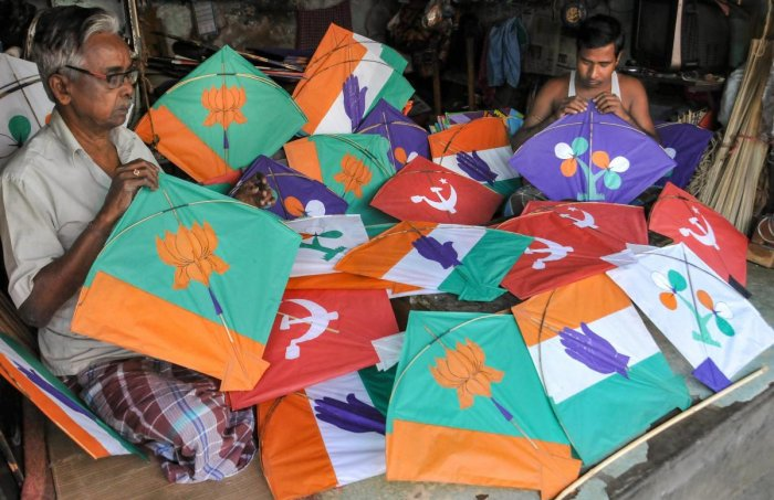 Kite makers prepare kites with different political party's symbols ahead of Lok Sabha elections, in Kolkata, Monday, March 18, 2019. (PTI Photo)