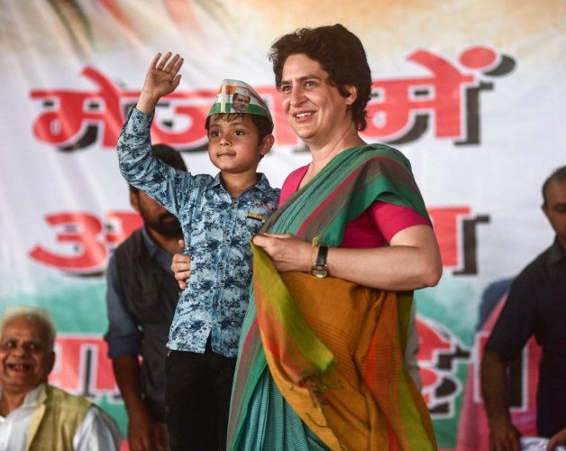 Congress General Secretary and Eastern Uttar Pradesh incharge Priyanka Gandhi Vadra interacts with villagers during her party's campaign for the upcoming Lok Sabha elections in UP, at Sirsa village in Prayagraj (Allahabad), Monday, March 18, 2019. (PTI Ph