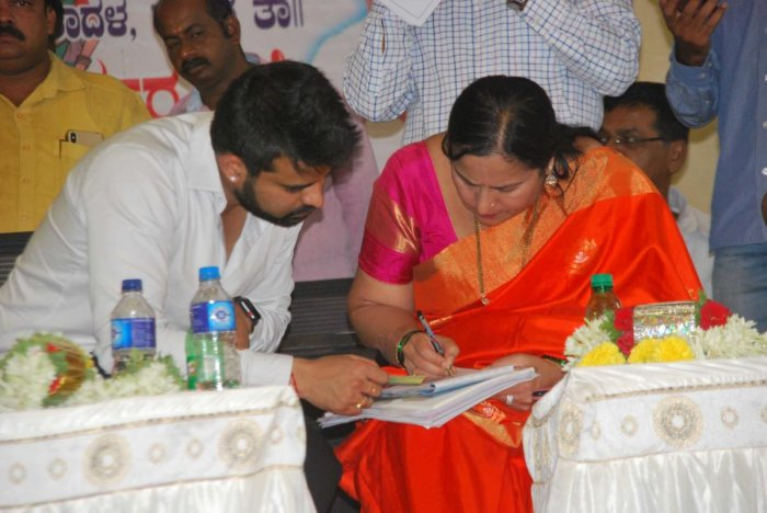 Congress-JD(S) coalition candidate Prajwal with his mother and ZP member Bhavani Revanna, during a party workers' meeting, in Hassan, on Wednesday.