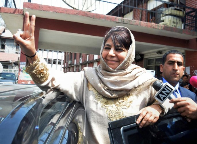 Peoples Democratic Party (PDP) chief and former chief minister Mehbooba Mufti shows victory sign as she leaves after filing her nomination papers from Anantnag, ahead of Lok Sabha elections, at Anantnag district of Kashmir, Wednesday, April 03, 2019. (PTI