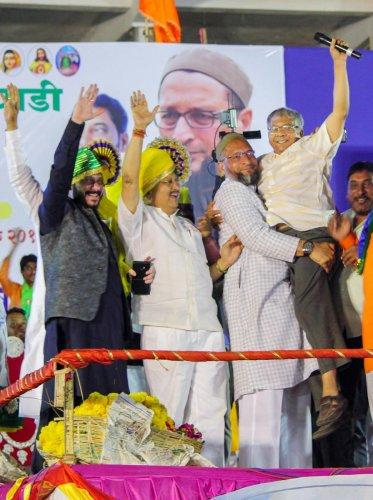 Solapur: AIMIM chief and Hyderabad MP, Asaduddin Owaisi carries Bharipa Bahujan Mahasangh leader Prakash Ambedkar during an election campaign rally for the Lok Sabha elections, in Solapur, Maharashtra, Wednesday, April 10, 2019. (PTI Photo)