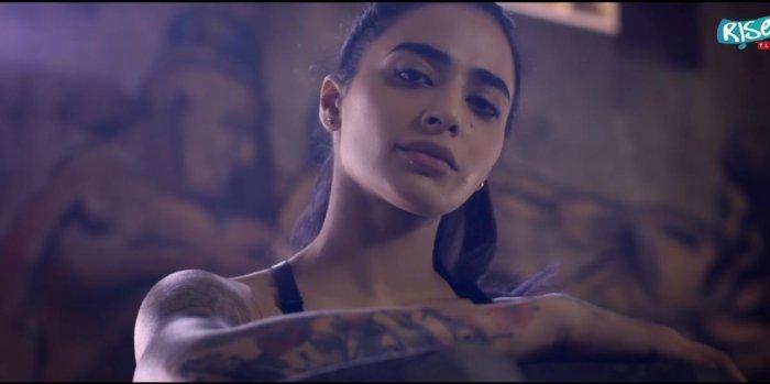 Bani J in her music video 'Miss Judged' has a dermal piercing below her lower lip.