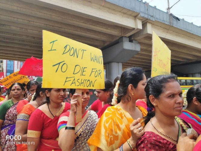 About 2,000 garment workers took out a rally on Wednesday from Kanteerava Studio to TVS junction in Peenya, demanding fair wages, better working conditions and protection from sexual harassment at the workplace.