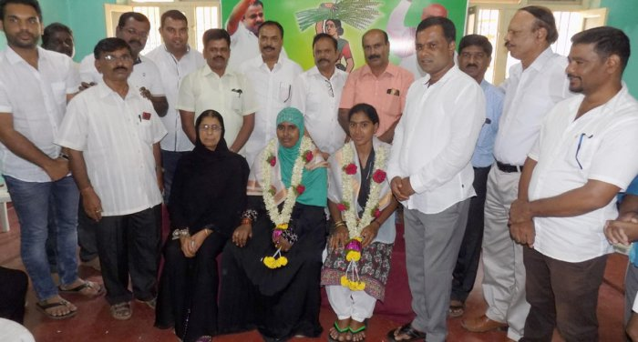 Labourers Sahina and Lakshmi were felicitated at the JD(S) office at the Labour Day programme in Chikkamagaluru on Wednesday.