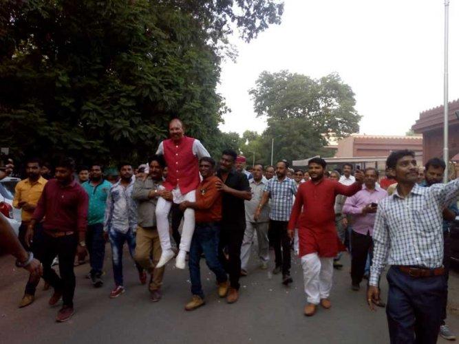 Celebrations outside D G Vanzara's residence in Gandhnagar. (DH Photo/Satish Jha)