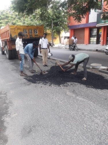 The traffic inspectors are directed to fill potholes in their jurisdictions.