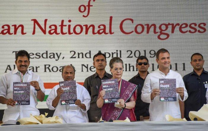 Congress President Rahul Gandhi, senior party leaders Sonia Gandhi, AK Antony and Congress General Secretary K C Venugopal release party's manifesto for Lok Sabha polls 2019, in New Delhi. PTI photo