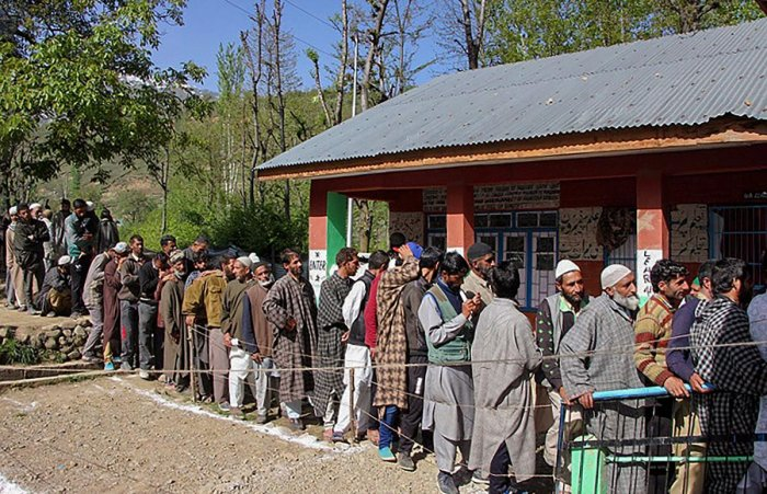 People wait in a long queue to cast their votes at a polling station, during the 4th phase of Lok Sabha elections, in Kulgam district of south Kashmir on April 29, 2019. (PTI Photo)