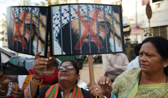 BJP supporters prepare to burn photos of Pakistan based terrorist Masood Azhar, in Ahmedabad on May 2, 2019, following the United Nations Sanctions Committee to include Jaish-e-Muhammad (JeM) chief Masood Azhar in its list of global terrorists. (AFP File Photo)