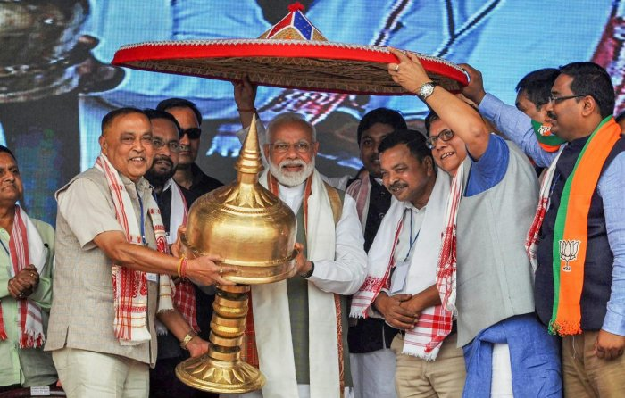 Prime Minister Narendra Modi being felicitated by his party leaders during an election rally ahead of Lok Sabha elections, at Gohpur, in Biswanath district, on Saturday. (PTI Photo)