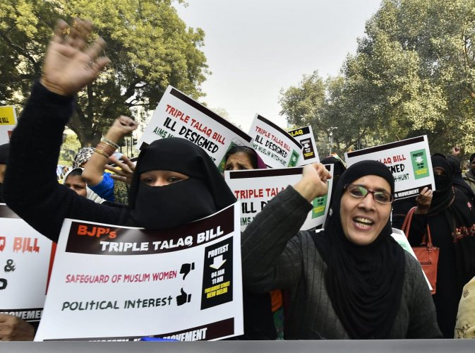 India Movement activists during a protest against the Triple Talaq Bill at Parliament Street, in New Delhi. PTI Photo