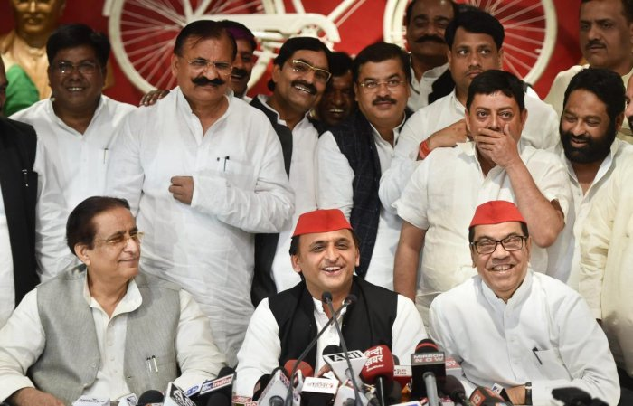 Samajwadi Party president Akhilesh Yadav with senior leaders Kiranmoy Nanda and Azam Khan addresses a press conference after the by-election results, at the party headquarters in Lucknow. (PTI File Photo)