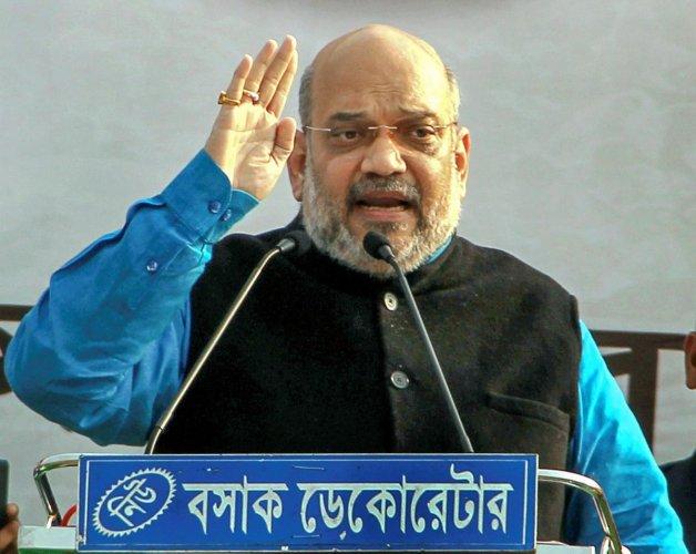 BJP National President Amit Shah addresses a rally, at Nitayapur in Malda. PTI photo