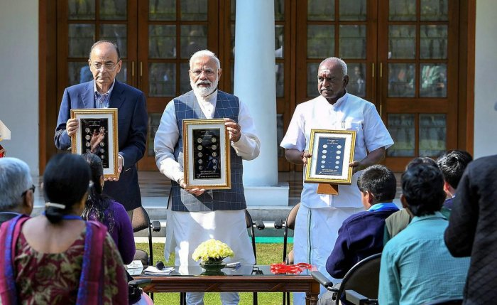 Prime Minister Narendra Modi releases a new series of visually impaired friendly circulation coins, at a function in New Delhi on Thursday. PTI