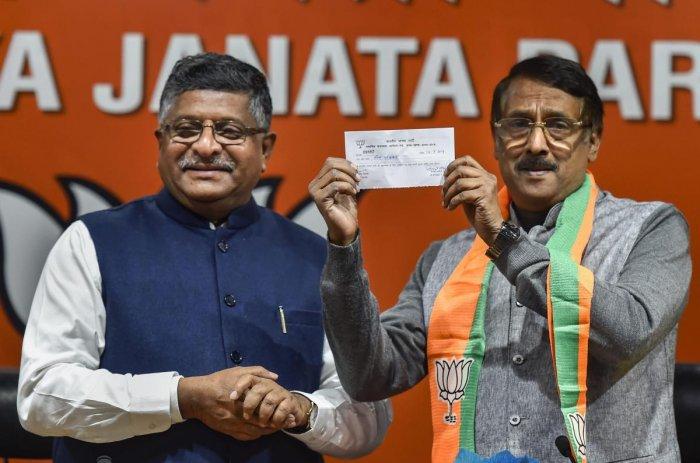 Bharatiya Janata Party senior leader Ravi Shankar Prasad and former Congress leader Tom Vadakkan after the latter joined Bharatiya Janta Party, in New Delhi on Thursday. (PTI Photo)