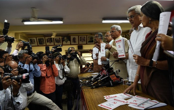 "Communist Party of India (M) general secretary Sitaram Yechury (3R), along with other leaders, poses with the party's manifesto for the ""General Election 2019"" at the CPM headquarters in New Delhi on March 28, 2019. AFP"