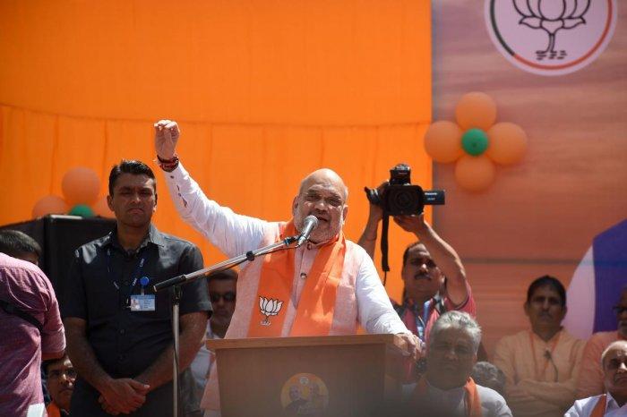 Bharatiya Janata Party (BJP) President Amit Shah speaks during his roadshow in Ahmedabad. AFP photo