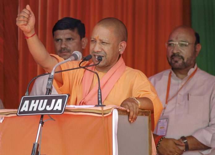 Uttar Pradesh Chief Minister Yogi Adityanath addresses an election rally in support of BJP candidate V K Singh, ahead of the Lok Sabha elections, in Ghaziabad, on March 31, 2019. PTI