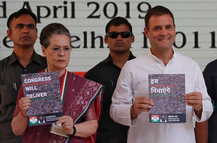 Rahul Gandhi, President of India's main opposition Congress party, and his mother and leader of the party Sonia Gandhi display copies of their party's election manifesto for the April/May general election in New Delhi, India, April 2, 2019. (REUTERS)
