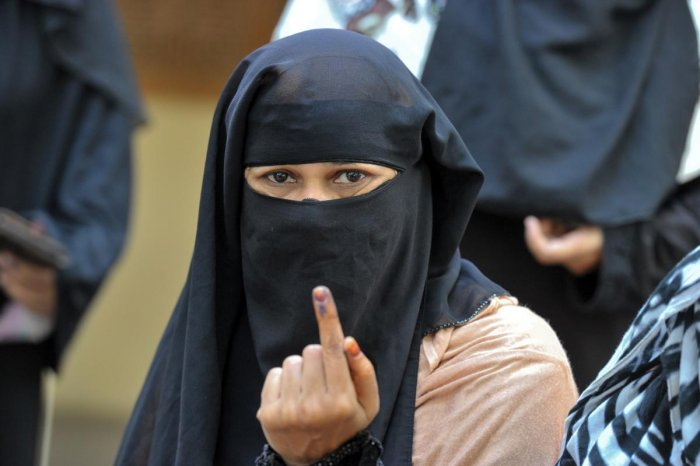 A Muslim shows her ink-marked finger after casting her vote at a polling station in Kurnool district, Andhra Pradesh. AFP