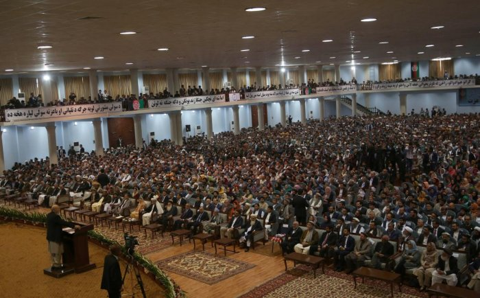 "Afghan people attend the first day of the ""loya jirga"" (grand assembly) in Kabul. - Afghanistan's usually bustling capital Kabul slowed to a crawl on April 30 amid massive security for a high-stakes peace summit that has previously been a target for insur"