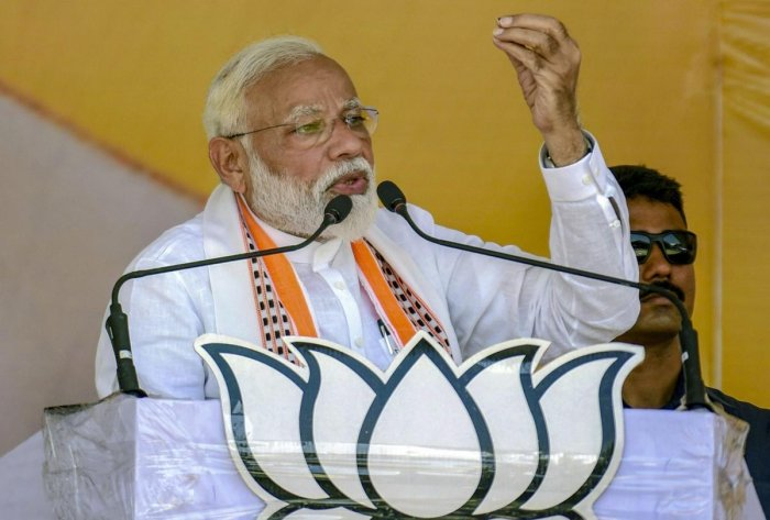 """Pehle upeksha, fir virodh, ab me too me too (They initially rejected it, then opposed and now saying 'me too' ),"" Modi said at an election rally. (PTI Photo)"
