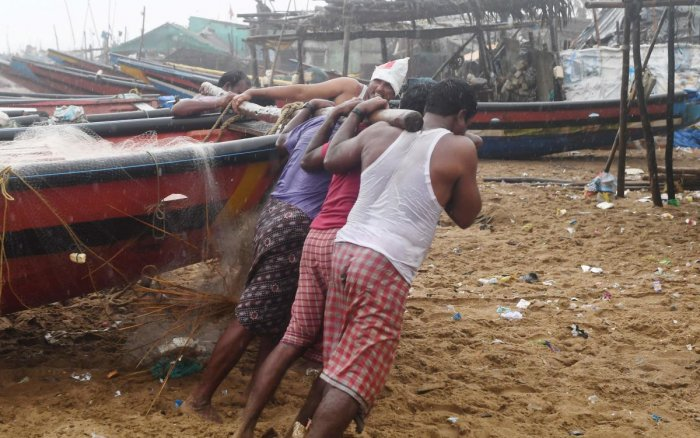 Fishermen pull a boat to higher ground on a beach in Puri in the eastern state of Odisha. AFP