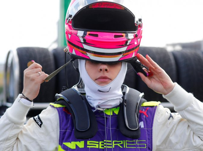 NEW FRONTIER: Spain's Marta Garcia straps on her helmet before a practice session on Friday. REUTERS