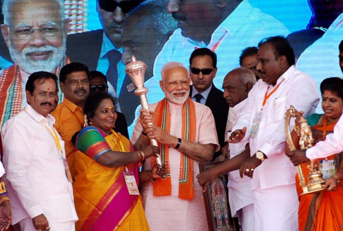Prime Minister Narendra Modi being felicitated by BJP leaders during a public meeting, in Madurai, Sunday, Jan. 27, 2019. (PTI Photo)